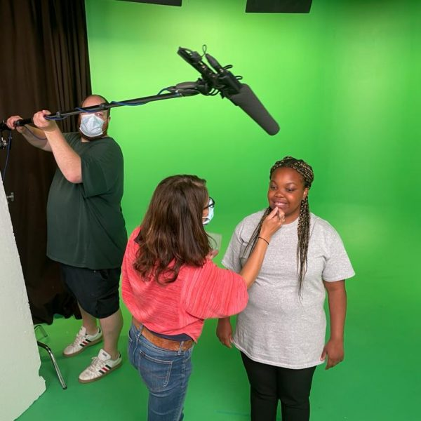 Green Screen Studio with make up artist and sound man wearing masks